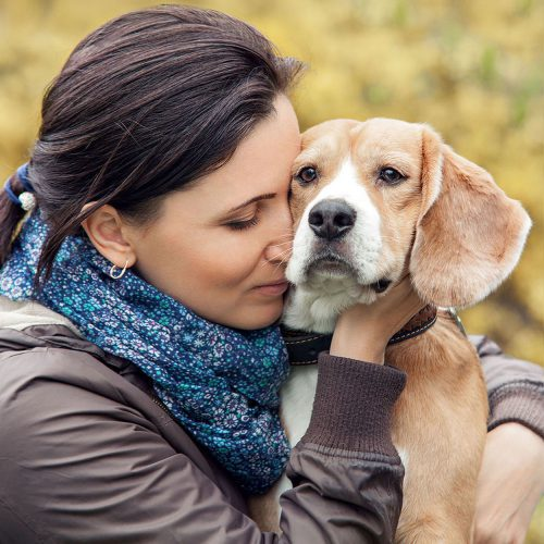 A lady with her pet dog, contemplating at-home pet euthanasia with Time2SayGoodbye.